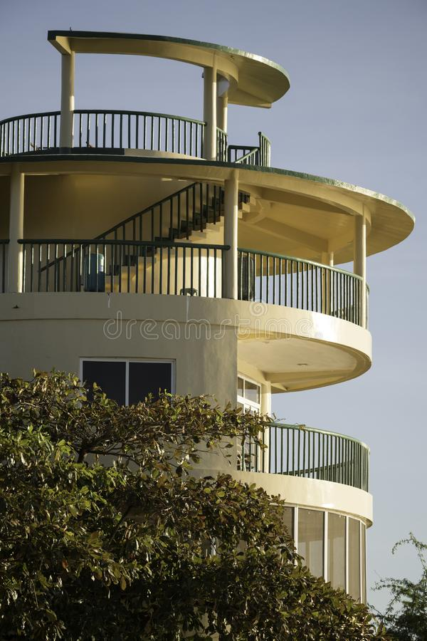 Circular building layered tower and function room, day susnset. On a beach in the northern province of Illocos Sur this unusual round building layered like coins stock images