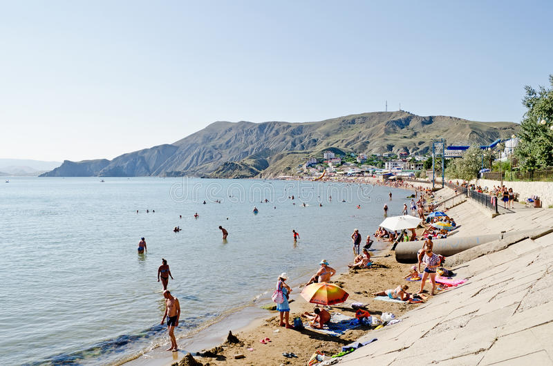 Beach in Ordzhonikidze. ORDZHONIKIDZE, UKRAINE - AUGUST 19: The cabinet of the Crimea forbade to take a payment for using of public beaches on August 19, 2013 in stock photos