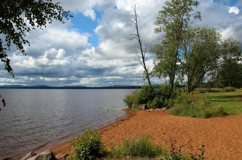 Beach by Orsa lake in Dalarna, Sweden, in August. Beach by Orsa lake in Dalarna, Sweden, in August 2017 royalty free stock image