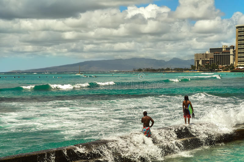 The beach on the Pacific Ocean in Hawaii USA, August 2012 , people standing a pier stock images