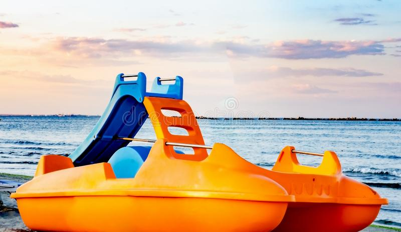 Beach paddle orange boats near seashore royalty free stock image