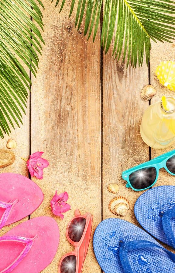 Beach, palm tree leaves, sand, sunglasses and flip stock photos