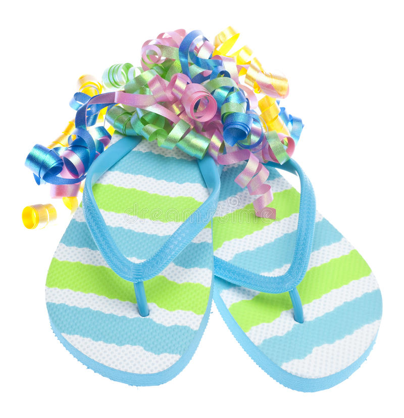 Beach Party Concept. With Streamers and Flip Flop Sandals Isolated on White royalty free stock images