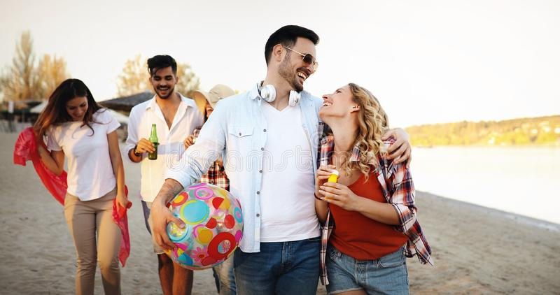 Beach party with friends. Cheerful young people spending nice time together on the beach stock photography
