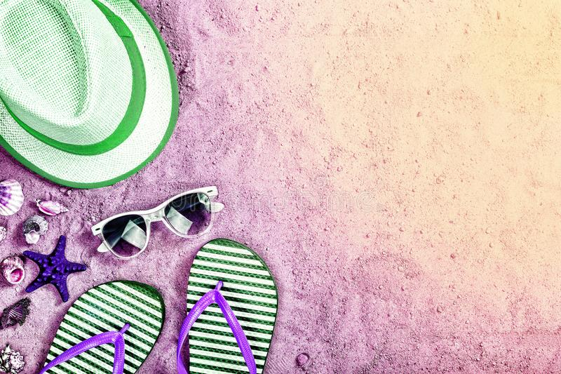 Beach party, summer sand background, neon lights, toned photo, sea, summer, top view, copy space. Beach party, neon lights, toned photo, summer sand background royalty free stock images