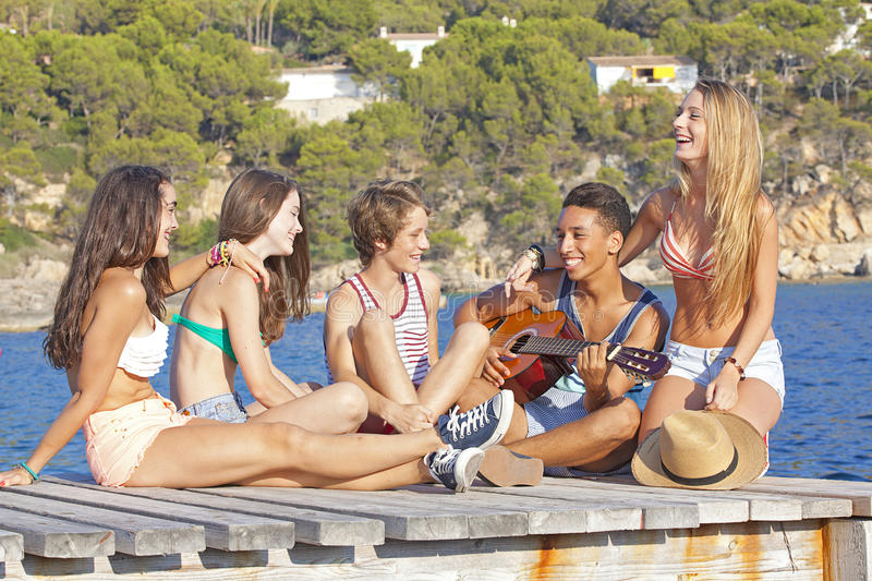 Beach party teens. With guitar in Majorca or Mallorca stock photography