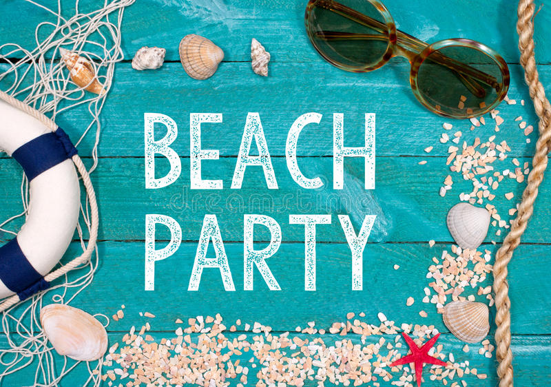Beach party. In text on weathered, blue wood framed with summer icons like life preserver, sunglasses, rope, sand and sea shells royalty free stock photography