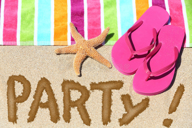 Beach party travel fun concept. PARTY written in sand with water next to beach towel, summer sandals and starfish. Summer and sun vacation holidays background royalty free stock photo