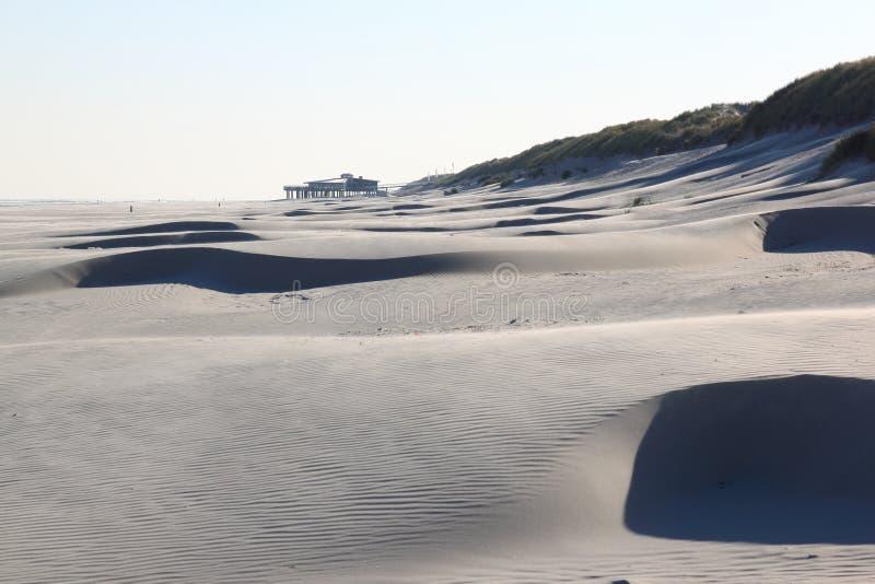 Beach pavilion and sand patterns, dutch Ameland Island stock image