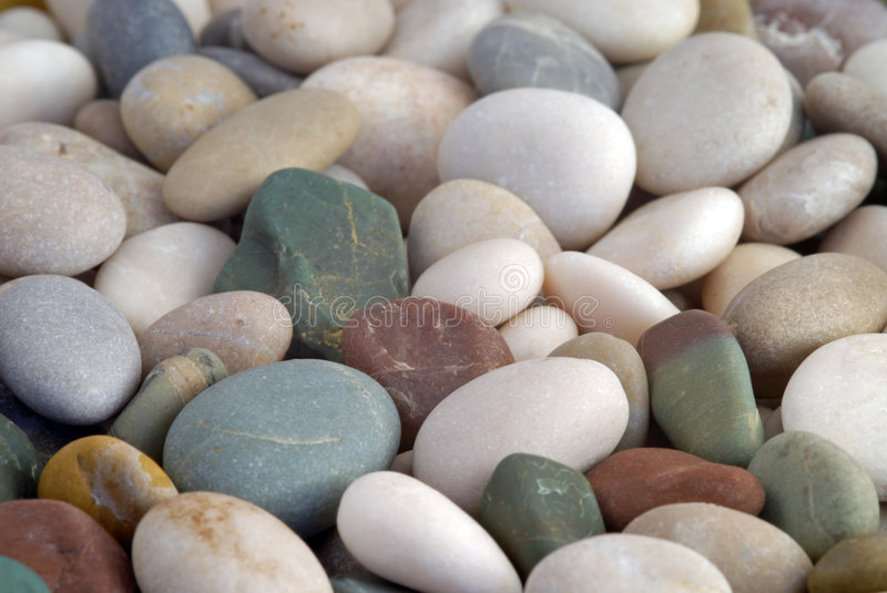 Beach pebbles background royalty free stock images