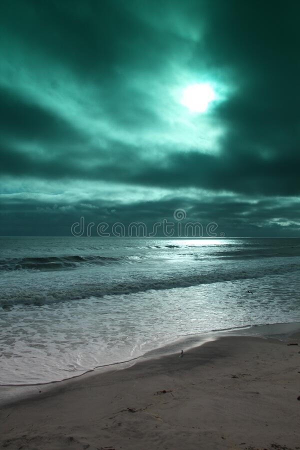 Beach photo using blue green filter. royalty free stock image