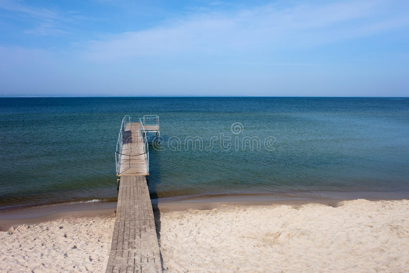 Beach with Pier in Hel Town at Baltic Sea royalty free stock photos
