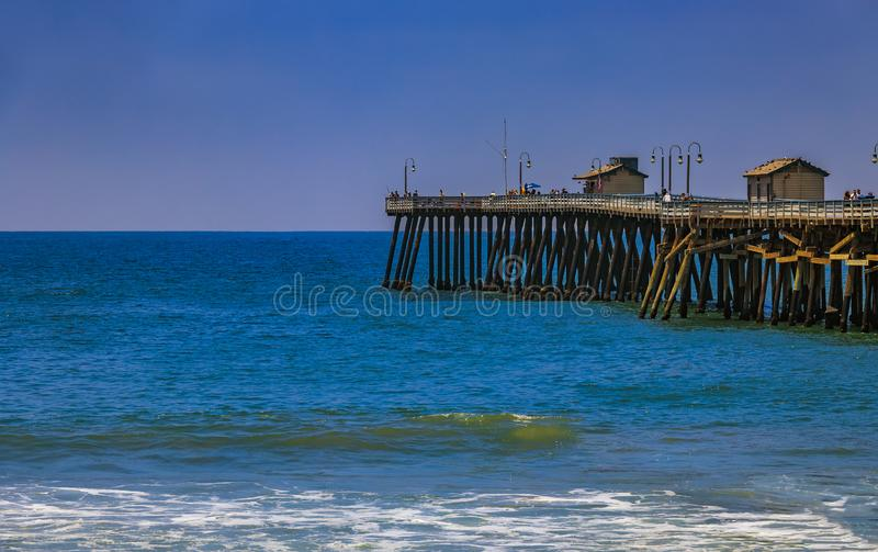 Beach and pier in San Clemente, famous tourist destination in California, USA. San Clemente, USA - July 03, 2017: Pacific ocean waves at the beach in a famous stock photos