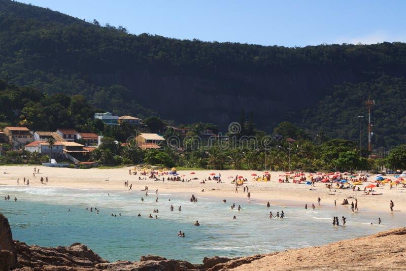 Beach Piratininga people Niteroi Rio de Janeiro. Beach Piratininga people waves mountain Niteroi Rio de Janeiro royalty free stock photography