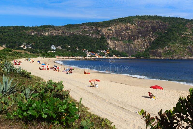 Beach Piratininga people sand sea Niteroi Rio de Janeiro. Beach Piratininga people mountain sand sea Niteroi Rio de Janeiro royalty free stock photo