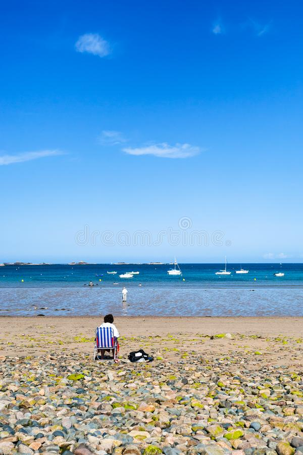 Beach Plage de la Baie de Launay n Brittany. Travel to France - man on beach Plage de la Baie de Launay on bay Anse de Launay of English Channel in Paimpol royalty free stock photography
