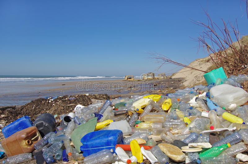 Beach plastics pollution. Pollution: Garbages, plastic, and wastes on the beach after winter storms stock image