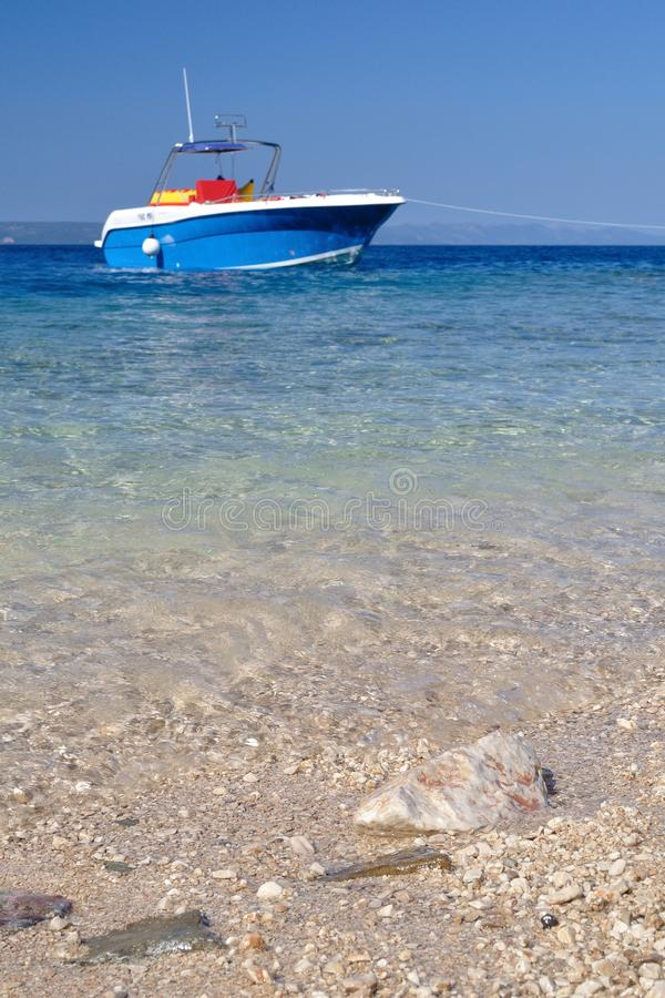 Beach of Podgora with some rocks and boat. Croatia royalty free stock image