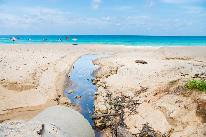 Beach pollution from dirty drainage sewer pipe royalty free stock image