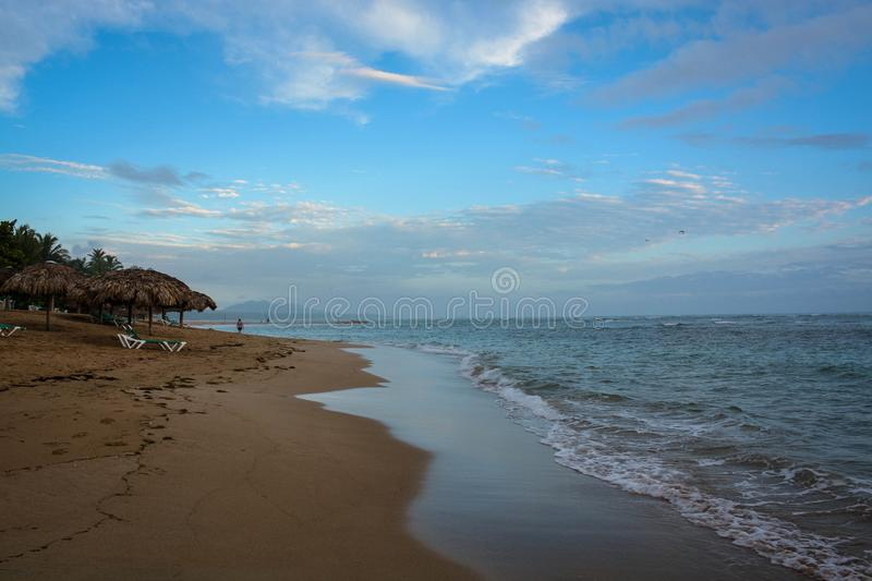 The Beach at Puerta Plata. A view of the beach at Puerta Plata, Dominican Republic on a beautiful morning before the crowds royalty free stock photo