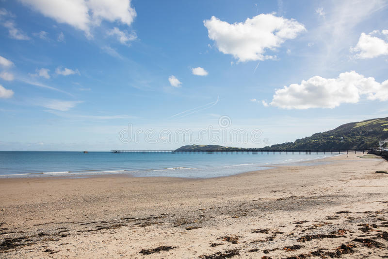Beach Ramsey Isle of Man. Sandy beach and long pier of Ramsey on the Isle of Man British Isles stock photos