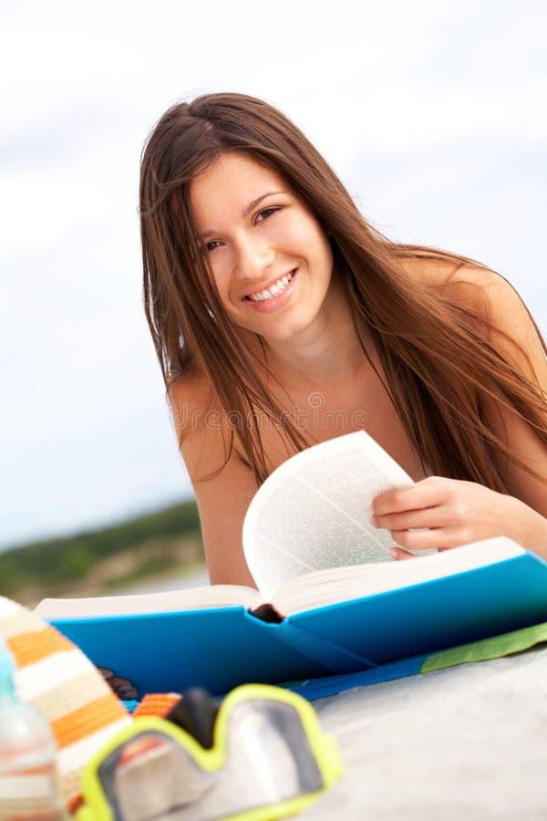 Beach reading royalty free stock photos