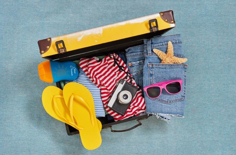 Beach ready suitcase stock photo