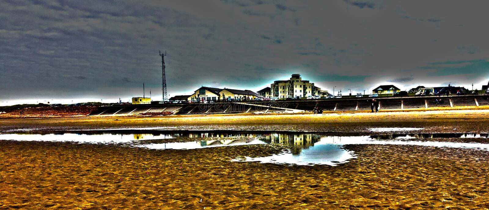 Beach Reflection. This a photo I took on one of my local beaches facing the sea. As you can see the reflection is really prominent and adds the feel of the royalty free stock photography
