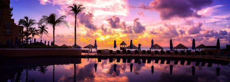 Cancun beach resort with palms stock photos