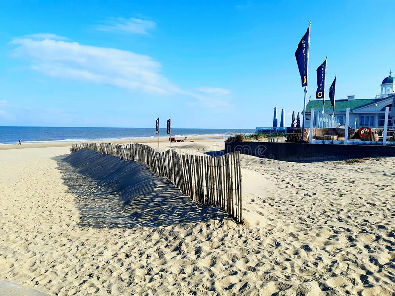 Beach and Restaurant. Netherlands, Europe. View of Nature and Civilization together. royalty free stock photo