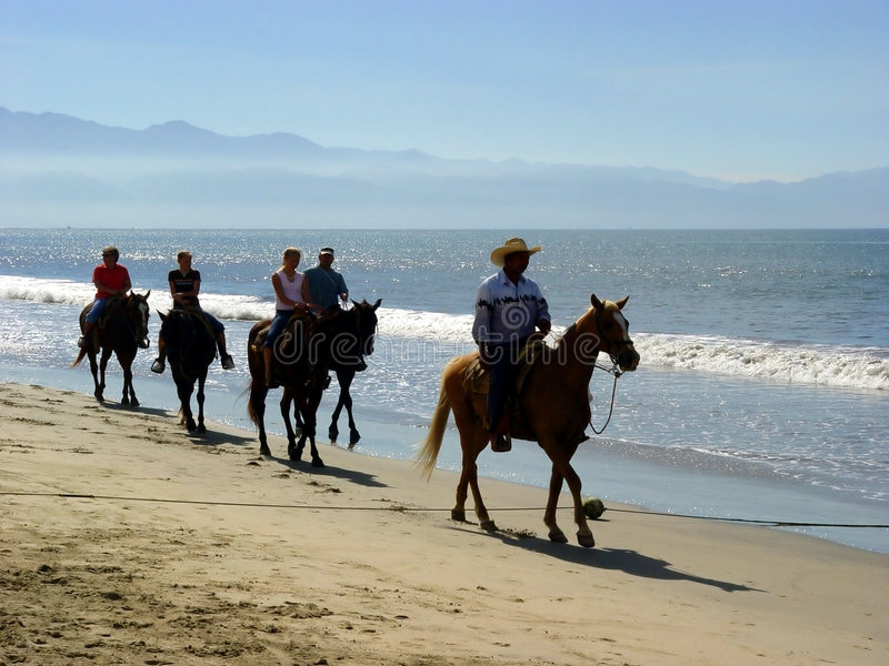 Beach riders stock images