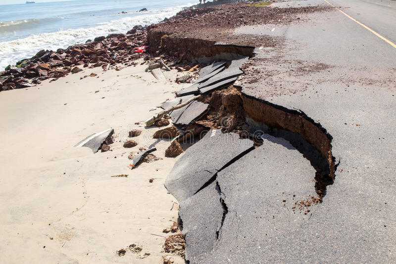 Beach Road slide along the beach to water erosion. Because storm stock photos