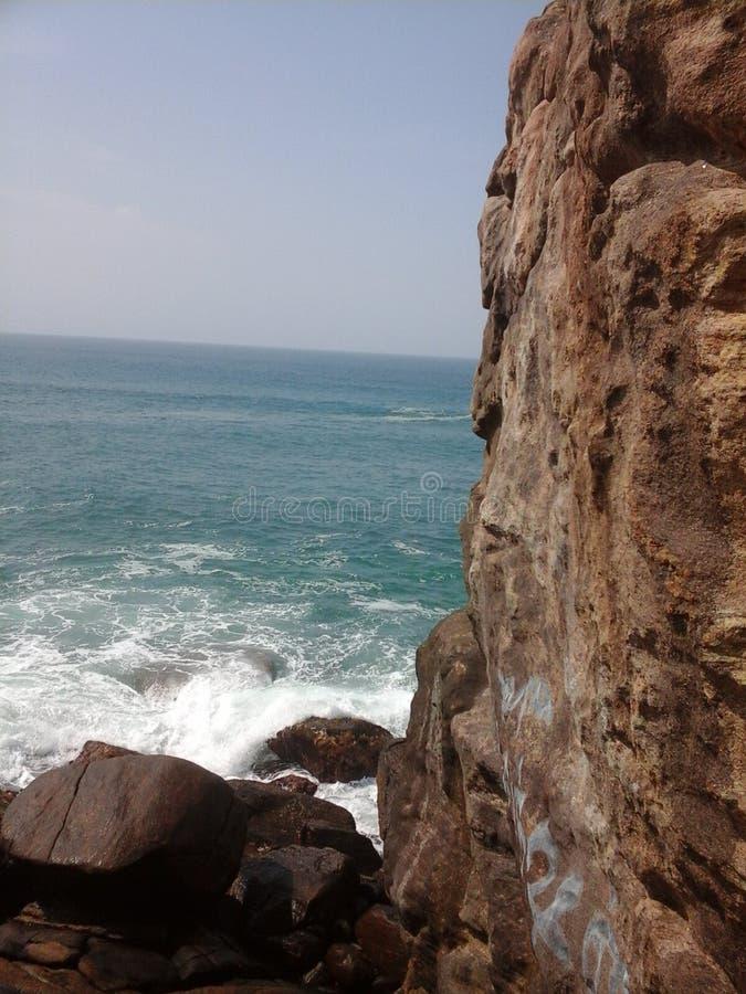 Beach and rock royalty free stock photos