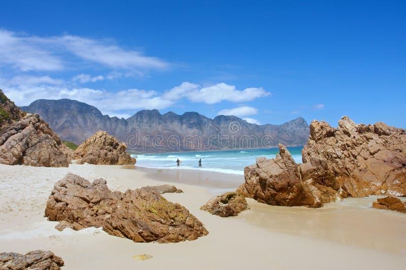 Beach, rocks, mountains stock photography