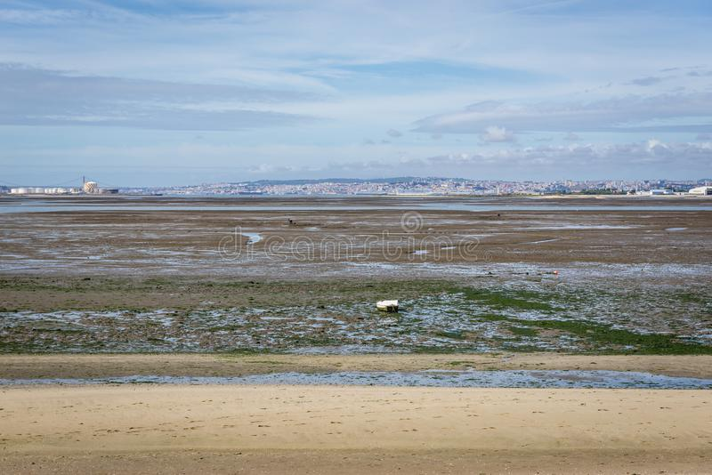 Beach in Rosario. Low tide of river Tagus in Rosario, small village near Moita, portugal royalty free stock image