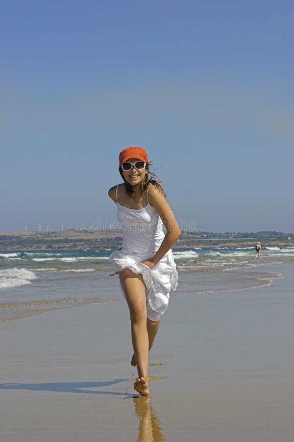 Beach running stock photos