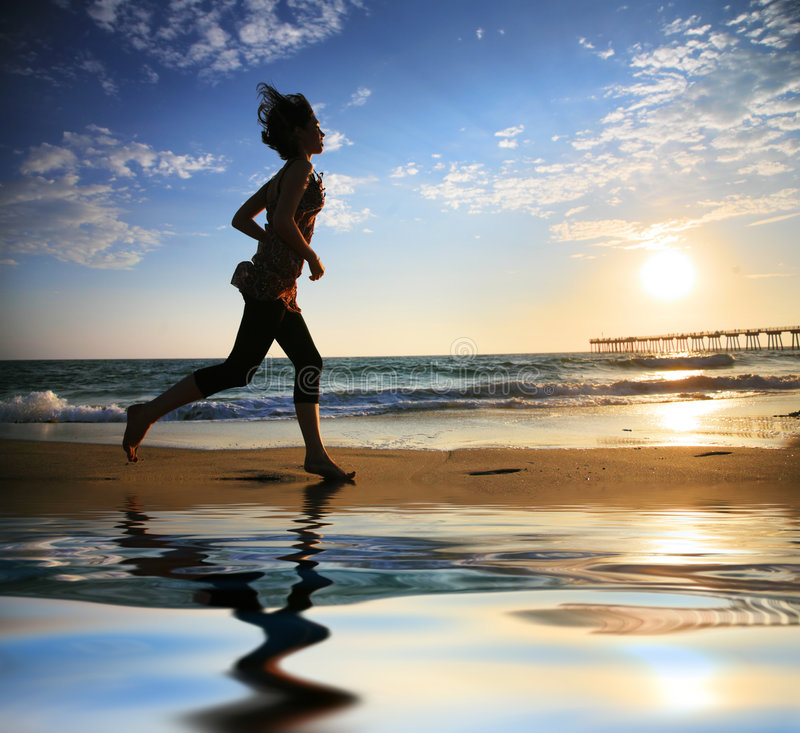 Download Beach running stock photo. Image of dusk, girl, reflection - 7442324