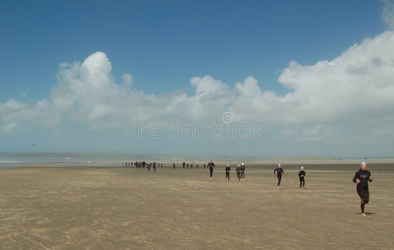 Beach running westward ho royalty free stock image