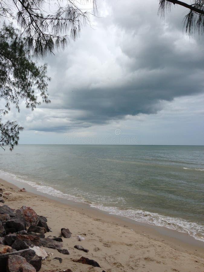 Beach& x27;s going rain royalty free stock photo