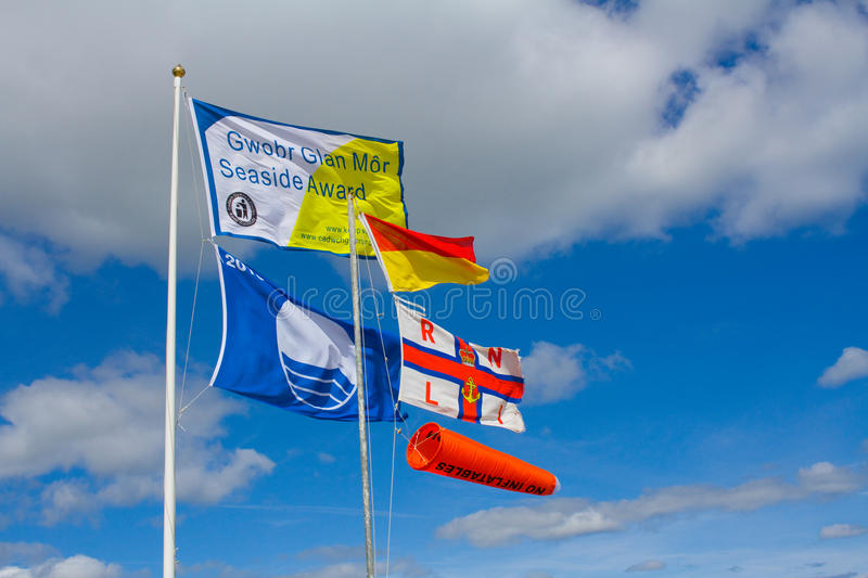 Beach safety flags. Including Blue Flag award, RLNI and No Inflatables stock image
