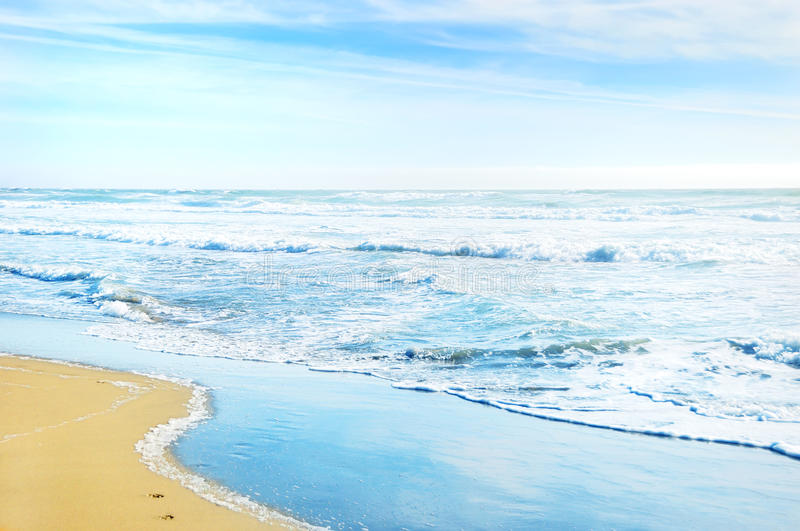 Beach in San Francisco California. With waves coming to the sand and blue sky background royalty free stock photos