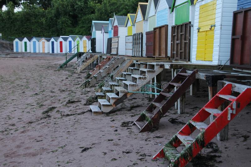 Beach huts in different colours in the city Torquay. stock photos
