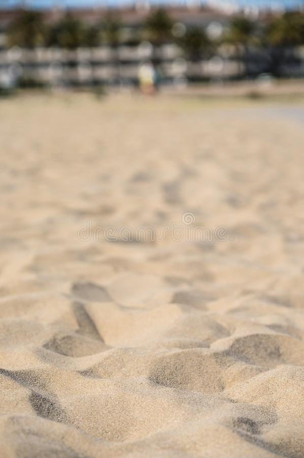 Beach sand with narrow depht of field. With the focus on the near sand royalty free stock photography