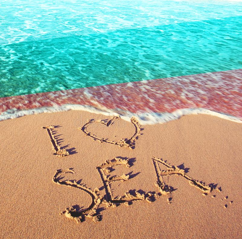Beach sand, sea and flag Bulgaria. I love Bulgaria concept.  royalty free stock photo