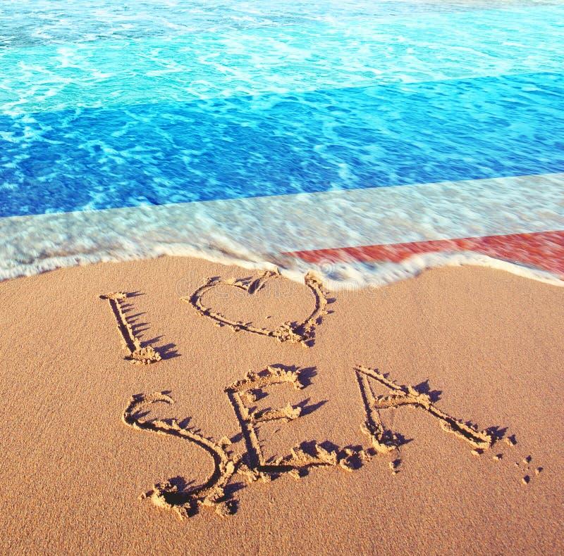 Beach sand, sea and flag Thailand. I love Thailand concept.  stock photography