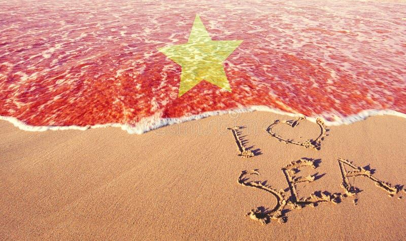 Beach sand, sea and flag vietnam. I love Vietnam concept.  stock photo