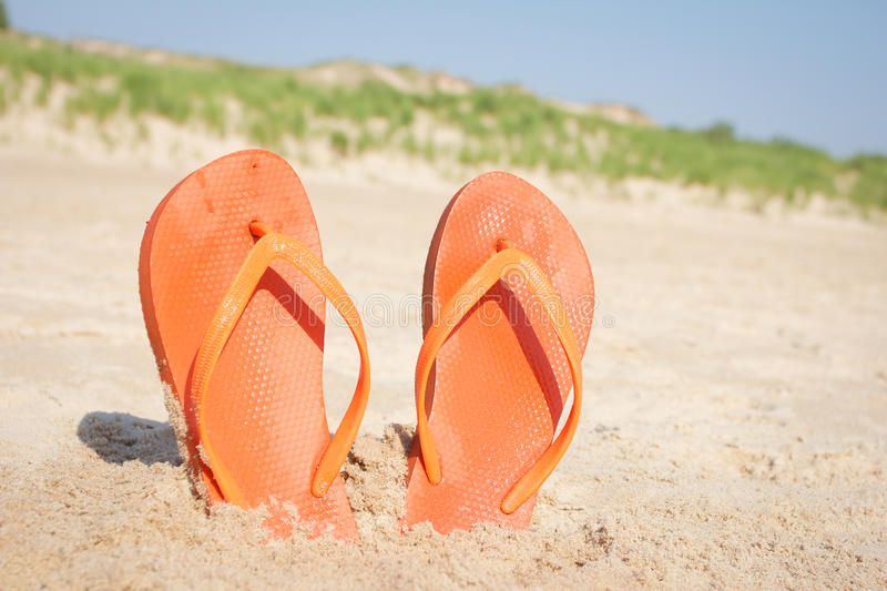 BEACH SANDALS IN SAND royalty free stock photography