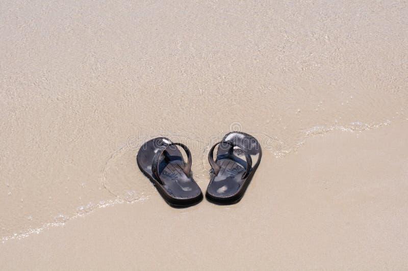 Beach Sandals On A Sandy Beach Royalty Free Stock Image