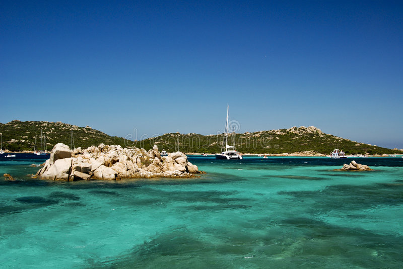 Beach in Sardenga. View of Budelli beach with stunning blue sea and boats in a sunny day - Sardegna - Italy 2008 royalty free stock photo