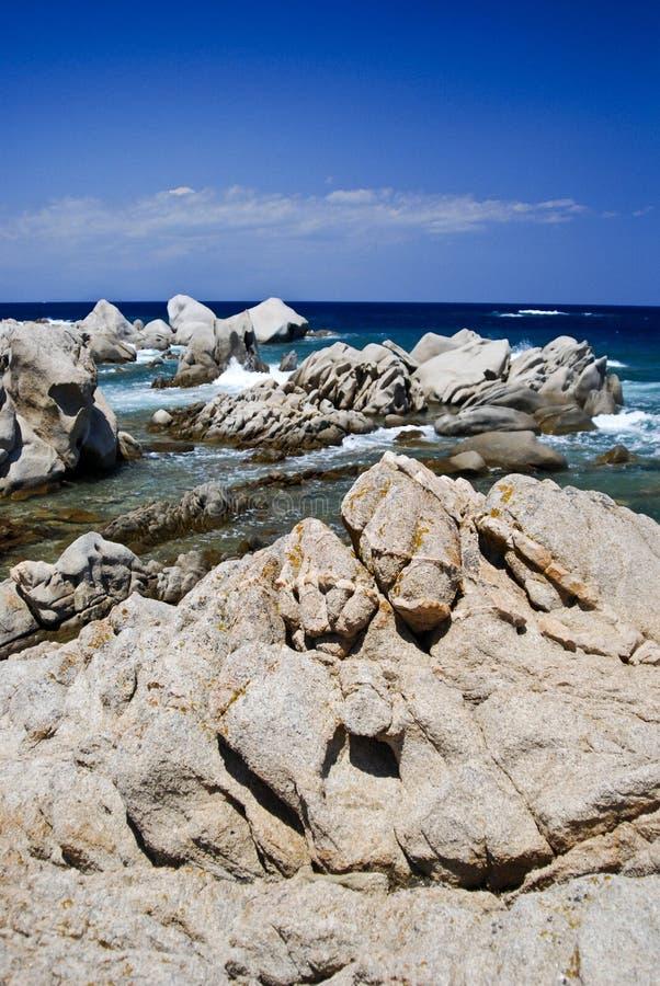 Beach in Sardenga. Stones of Porto Faro with blue sea in a sunny day - Sardegna - Italy 2008 stock images